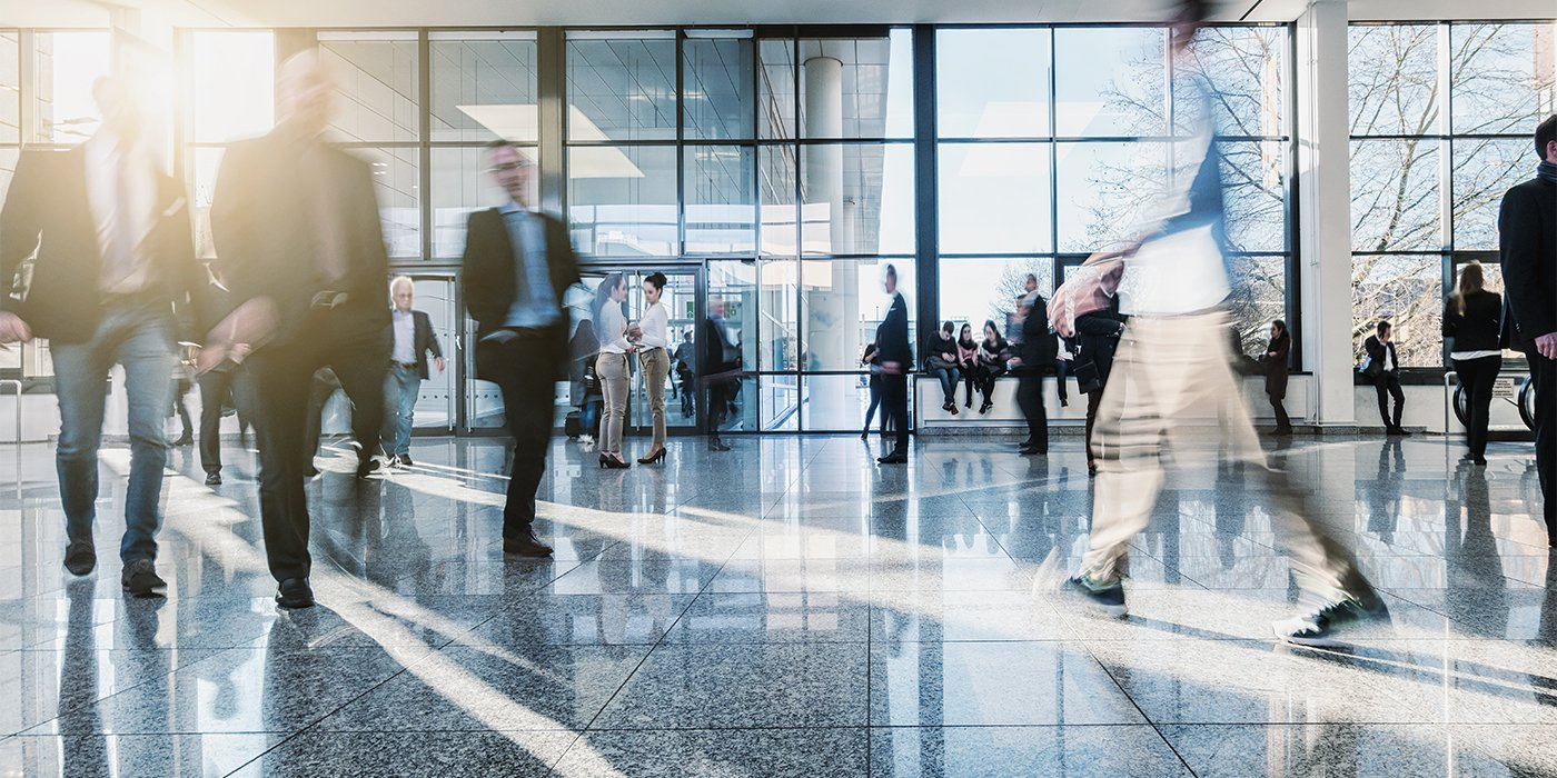 Blurred-Crowd-in-an-Open-Hall-wResilient-Flooring_583320193_1400x700