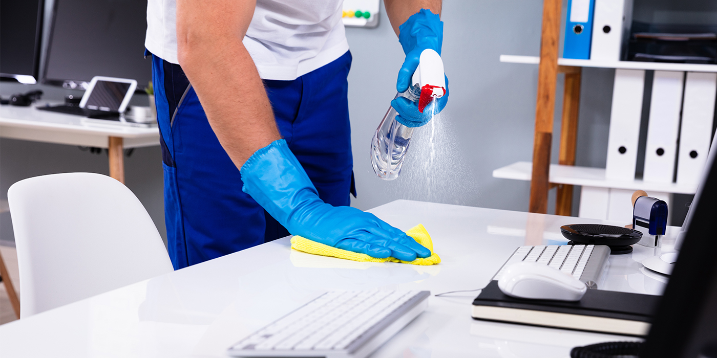 Janitor-Cleaning-&-Disinfecting-Office-Desk_1401013190_1400x700